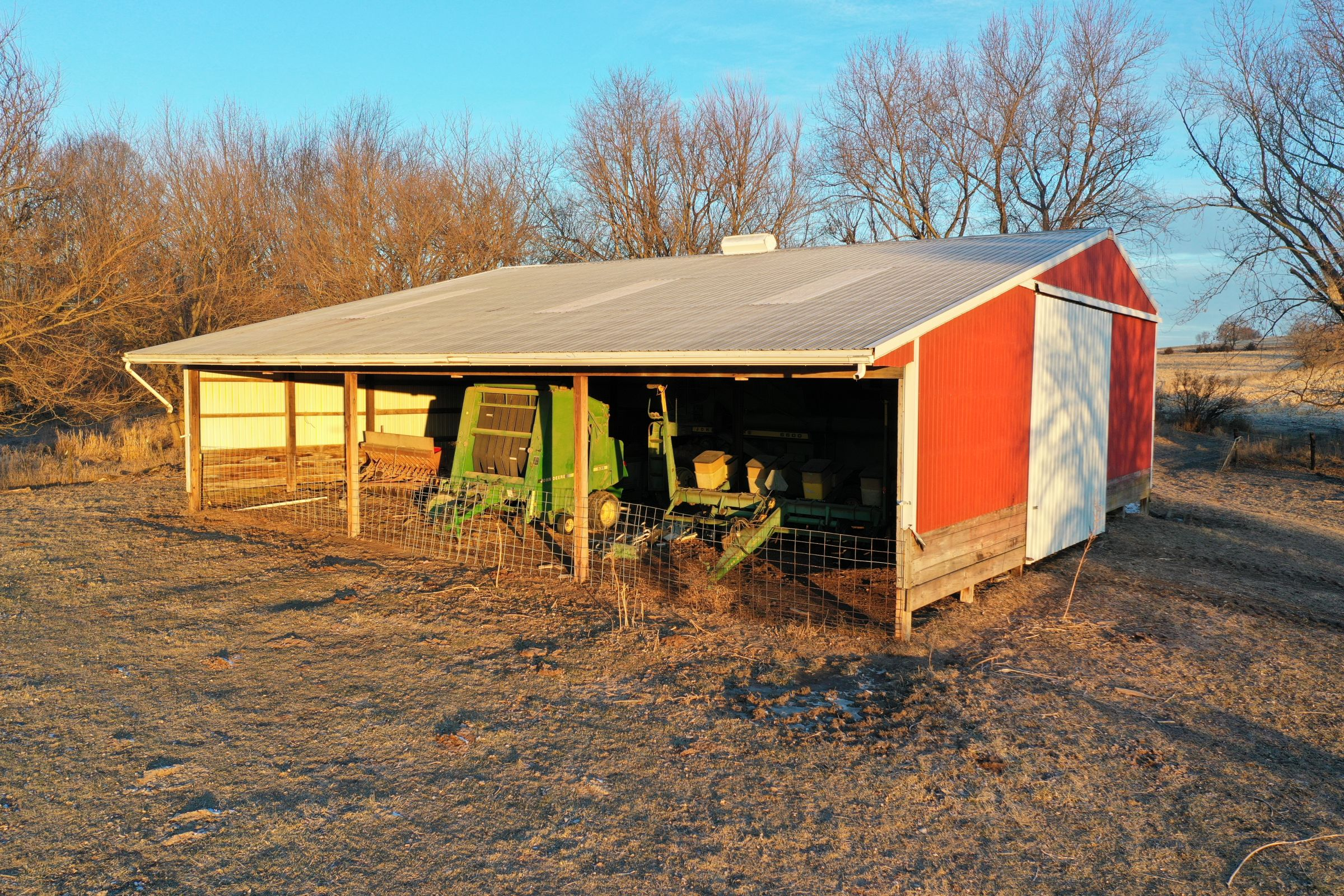 Functional and well-maintained open front cattle and machine shed that measures approximately 53 ft. x 47 ft in Guthrie Center, Iowa